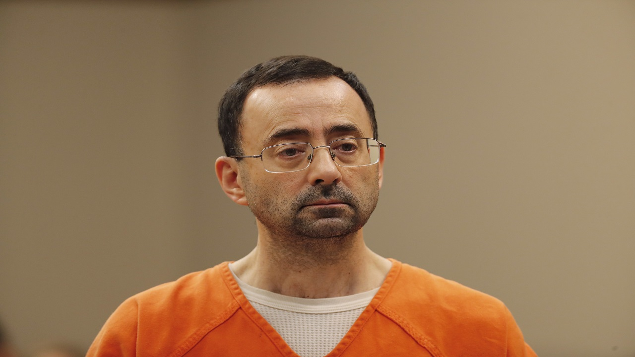 In this Nov. 22, 2017, file photo, Dr. Larry Nassar, appears in court for a plea hearing in Lansing, Mich.