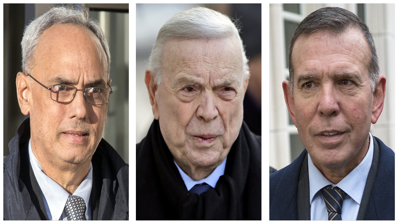 In these 2017 file photo, three former South American soccer officials, from left, Manuel Burga, of Peru; Jose Maria Marin, of Brazil; and Juan Angel Napout, of Paraguay, accused of accepting millions of dollars in bribes, are shown outside federal court in the Brooklyn borough of New York.