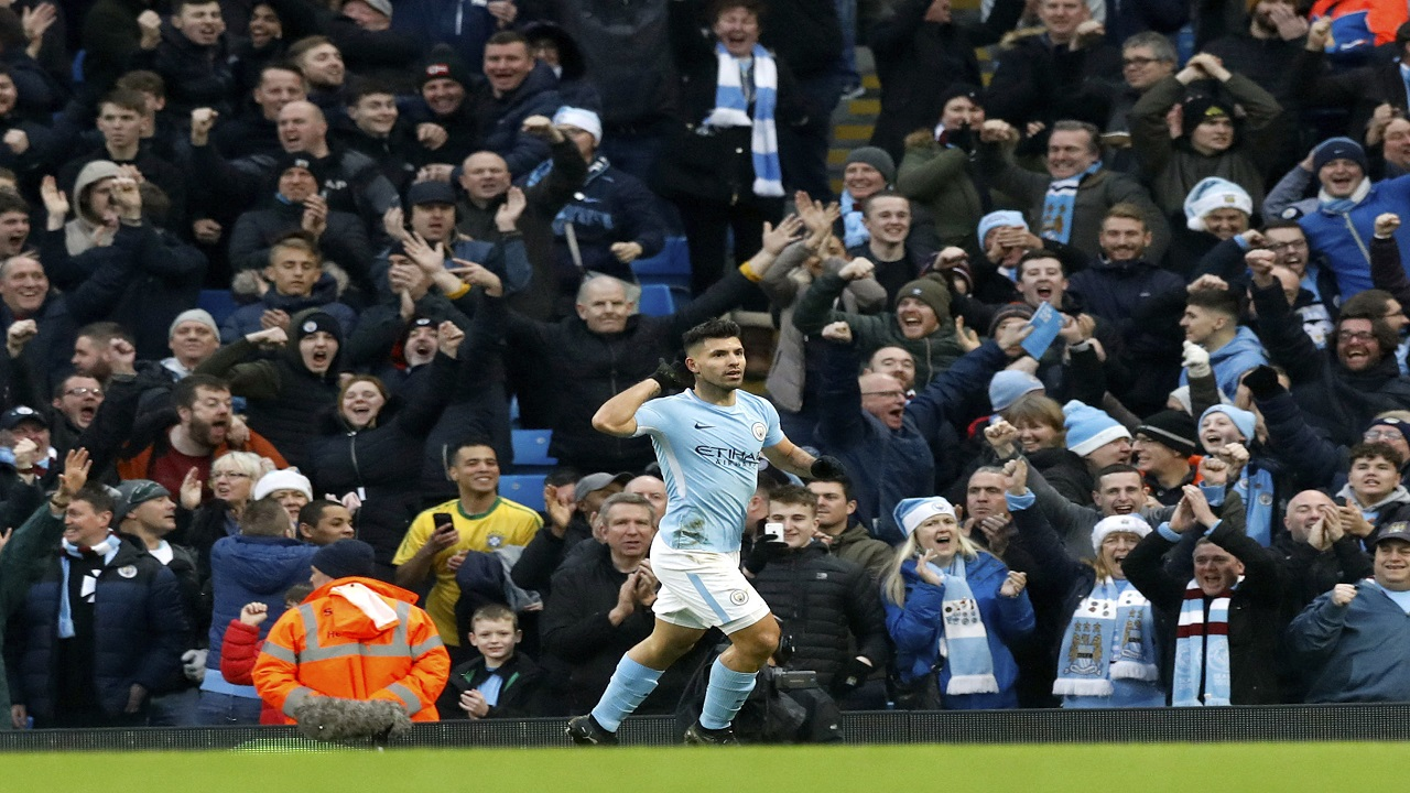 Manchester City's Sergio Aguero celebrates scoring his side's first goal of the game, during their English Premier League football match against Bournemouth, at the Etihad Stadium, in Manchester, England, Saturday, Dec. 23, 2017.