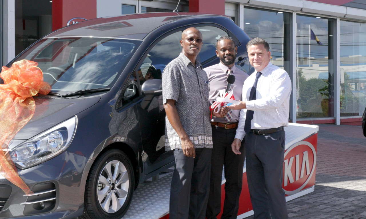 Photo caption: Roger Taylor (left) of Cosmopolitan Pharmacy receiving the keys from Pedro Callendar, Sales Executive and Nicholas Mouttet CEO & President of ANSA McAL (Barbados)