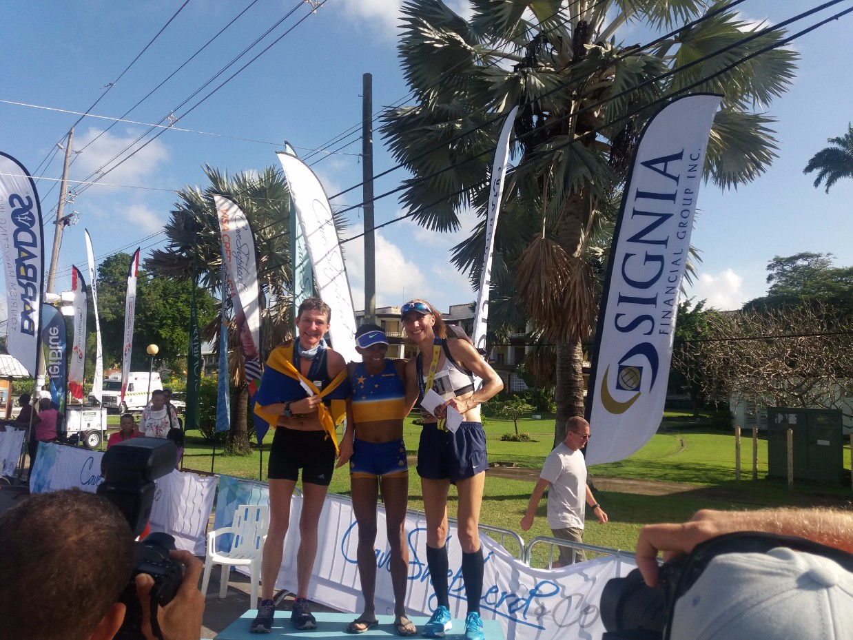 The top three women in the 2017 Run Barbados Marathon. (L-R) Tracey West was second in the Female Division of the marathon, Felix Fanja of Martinique took the top prize and Carolyn Murray was the third women to finish.