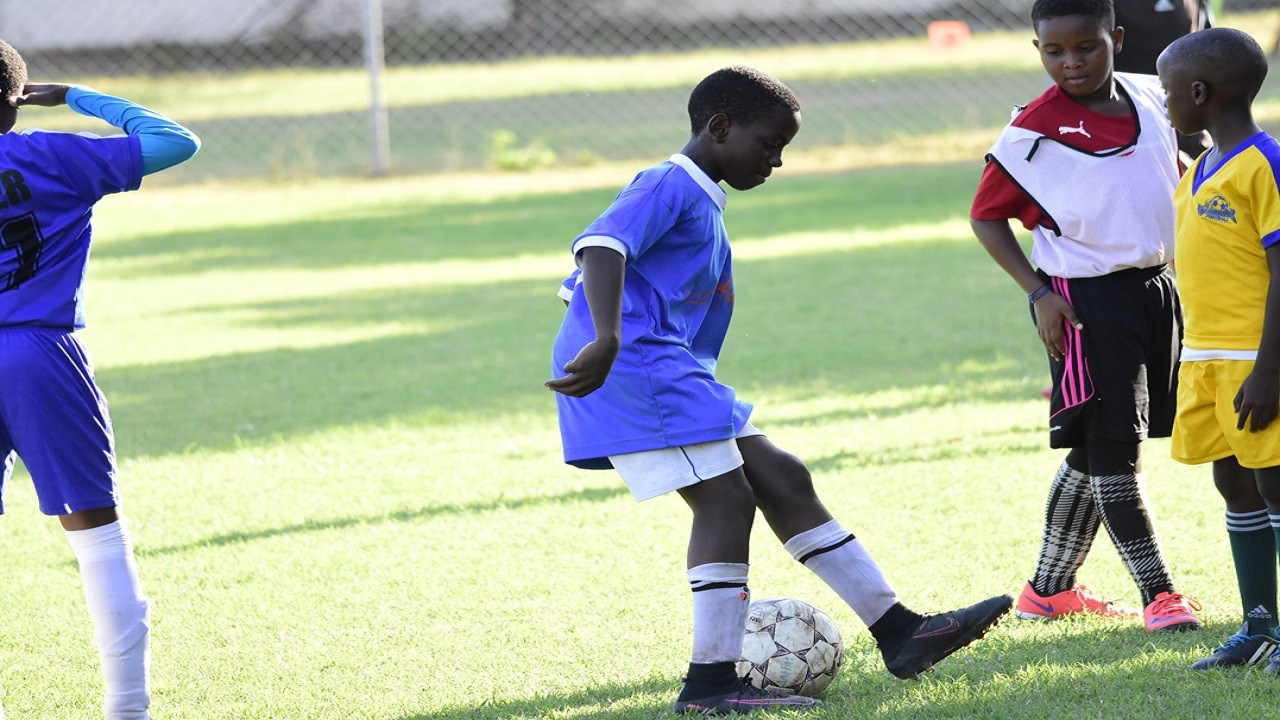 A Winchester Academy student plays with a ball during the academy's end-of-year tournament at Winchester Park in Kingston over the holidays. (PHOTOS: Marlon Reid)
