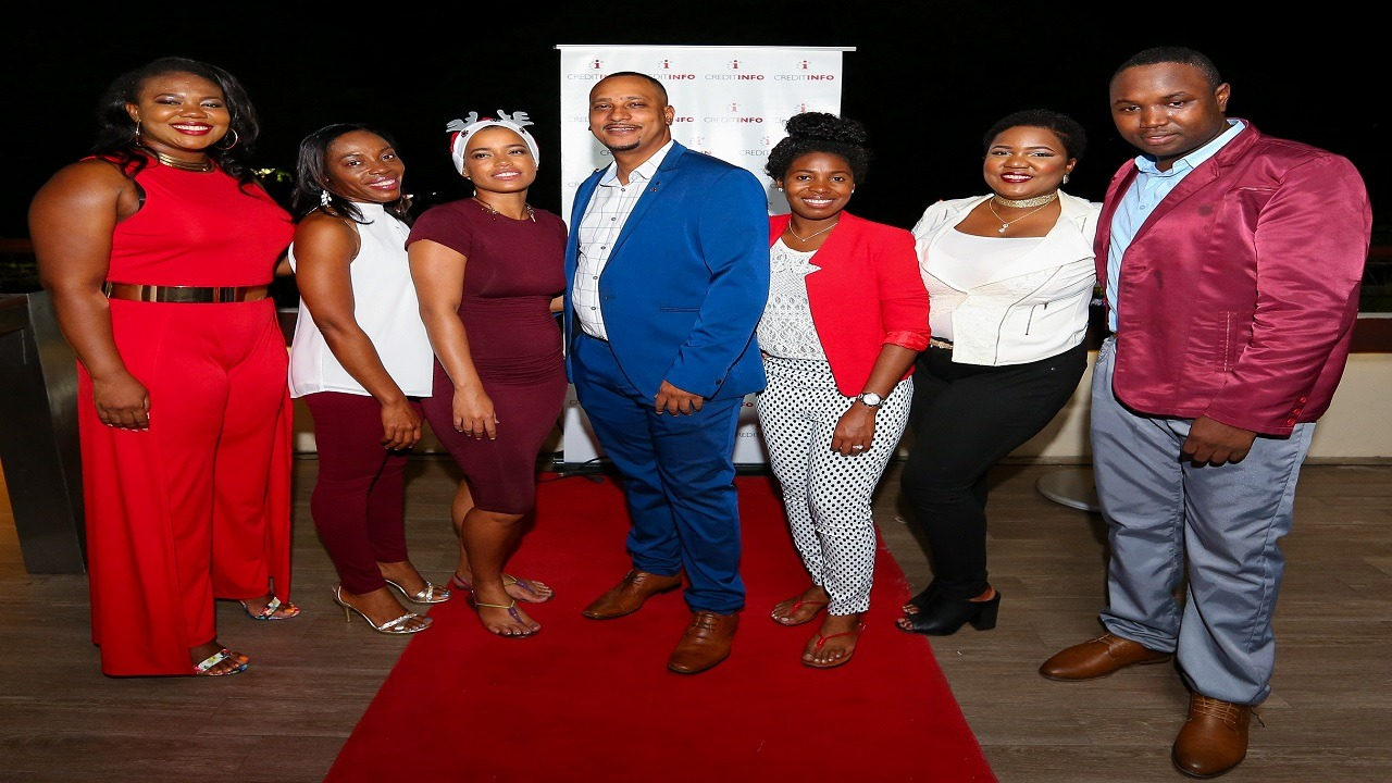 Creditinfo Jamaica CEO Craig Stephen (centre) with staff members at the company's annual Christmas party last Friday. (PHOTOS: Contributed)