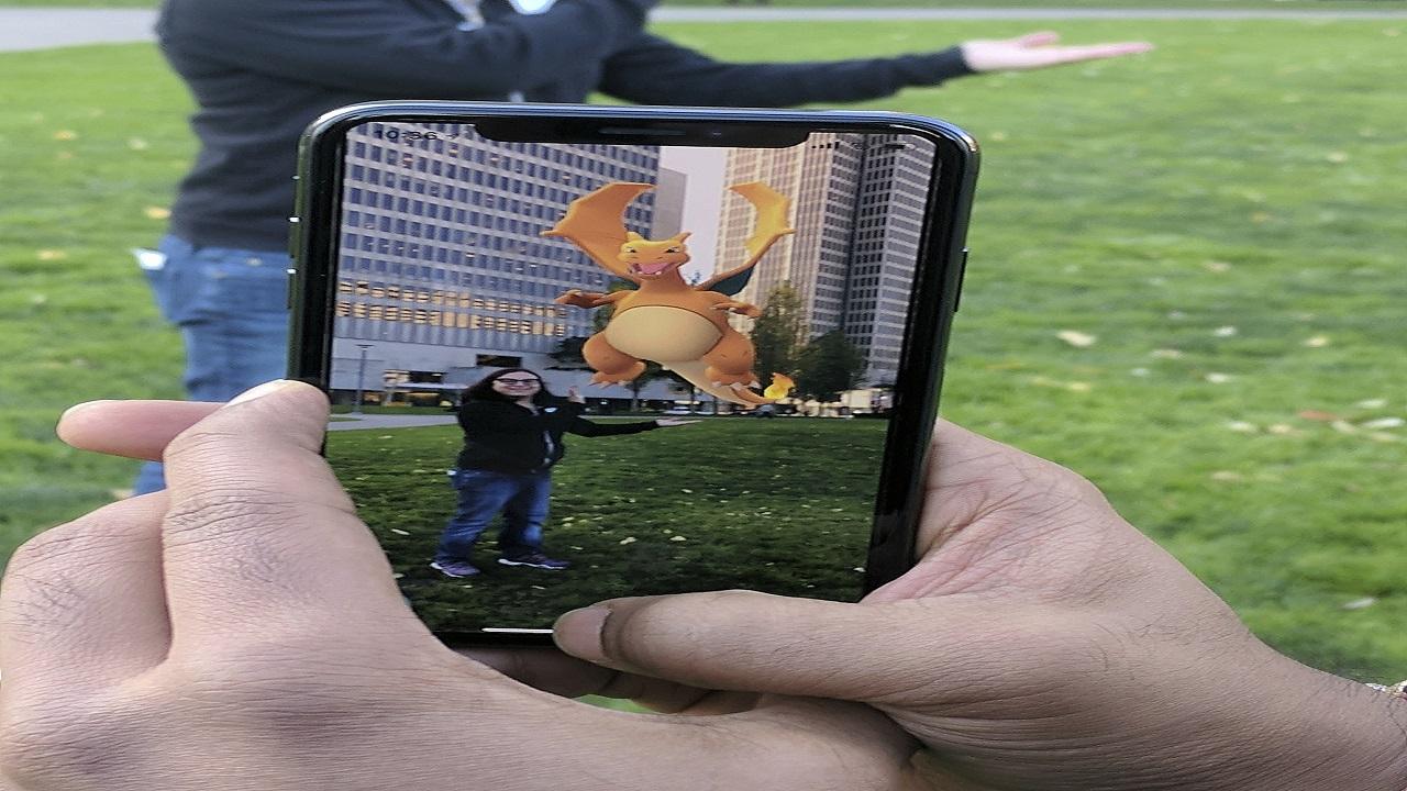 In this Monday, Dec. 18, 2017, photo, Pokemon Go is played at a park in San Francisco. Pokemon Go is unleashing its digital critters in Apple's playground for augmented reality, turning iPhones made during the past two years into the best place to play the mobile game, according to the CEO of the company that makes Pokemon Go.