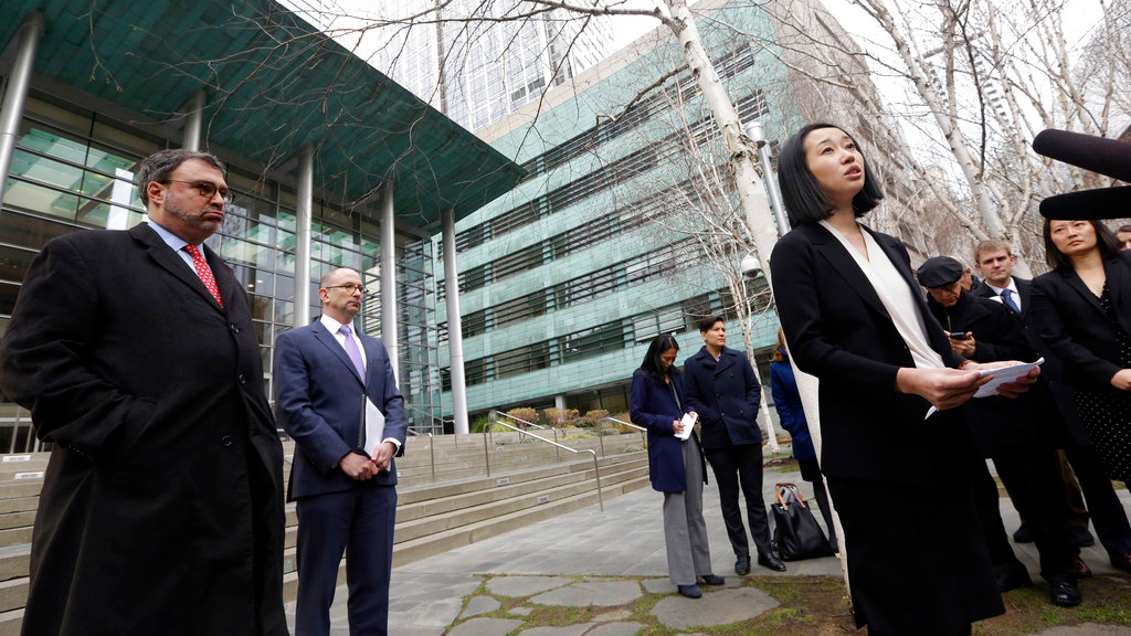 Mariko Hirose, right, a litigation director at the Urban Justice Center, addresses reporters as Mark Hetfield, president & CEO of HIAS, left, and Rabbi Will Berkowitz, Jewish Family Service of Seattle CEO, look on in front of a federal courthouse after speaking with media in Seattle. The government has asked a federal judge to change his order that partially lifted a Trump administration refugee ban.