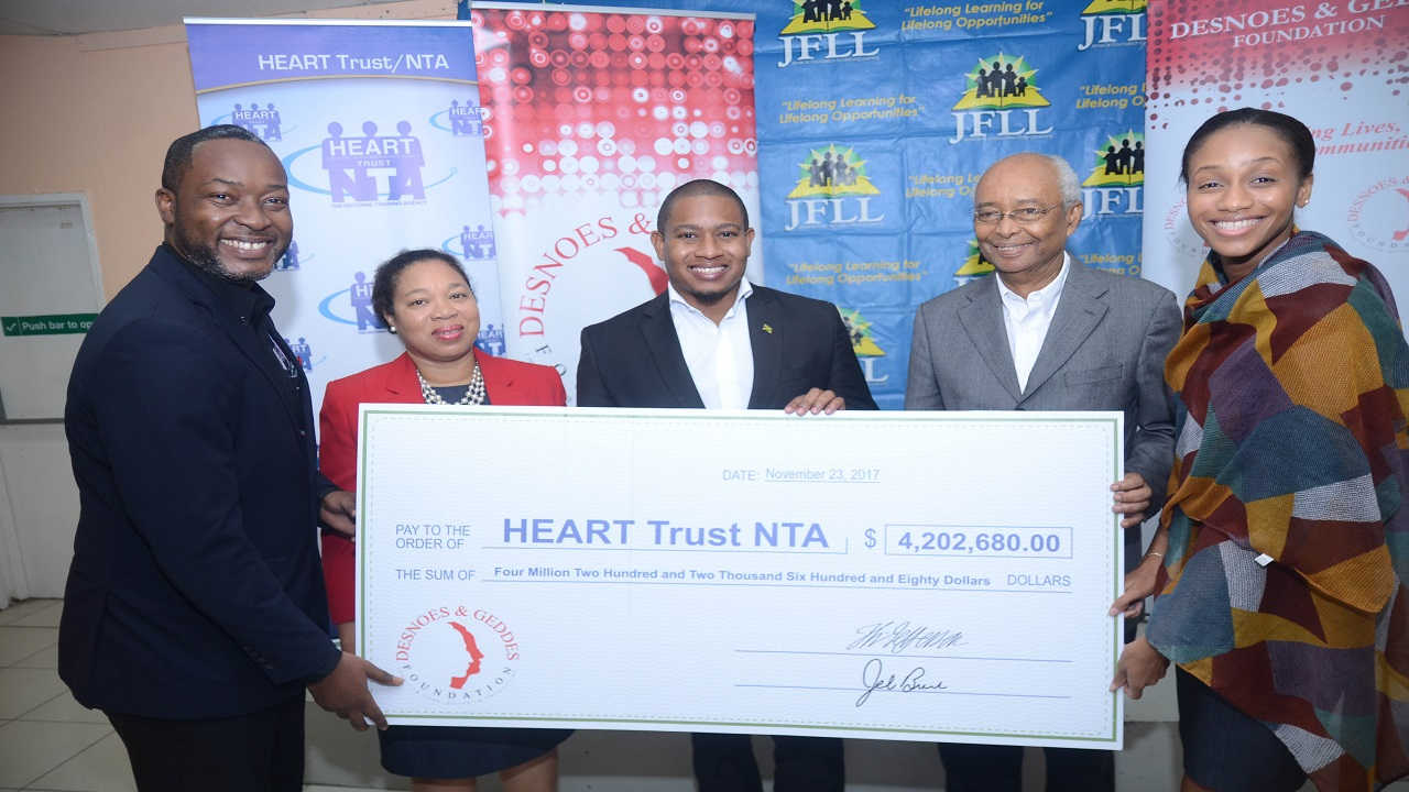 Floyd Green (centre) State Minister in the Ministry of Education and Youth shares in a photo op with (from left) Garth Williams, Sustainability Manager, Red Stripe; Dr. Marcia Rowe-Amonde, Senior Director, TVET Development and Support System, HEART Trust/NTA; Noel daCosta, Chairman, Desnoes and Geddes (D&G) Foundation; and Rhoda Crawford, Education Services Director, Jamaica Foundation for Lifelong Learning.