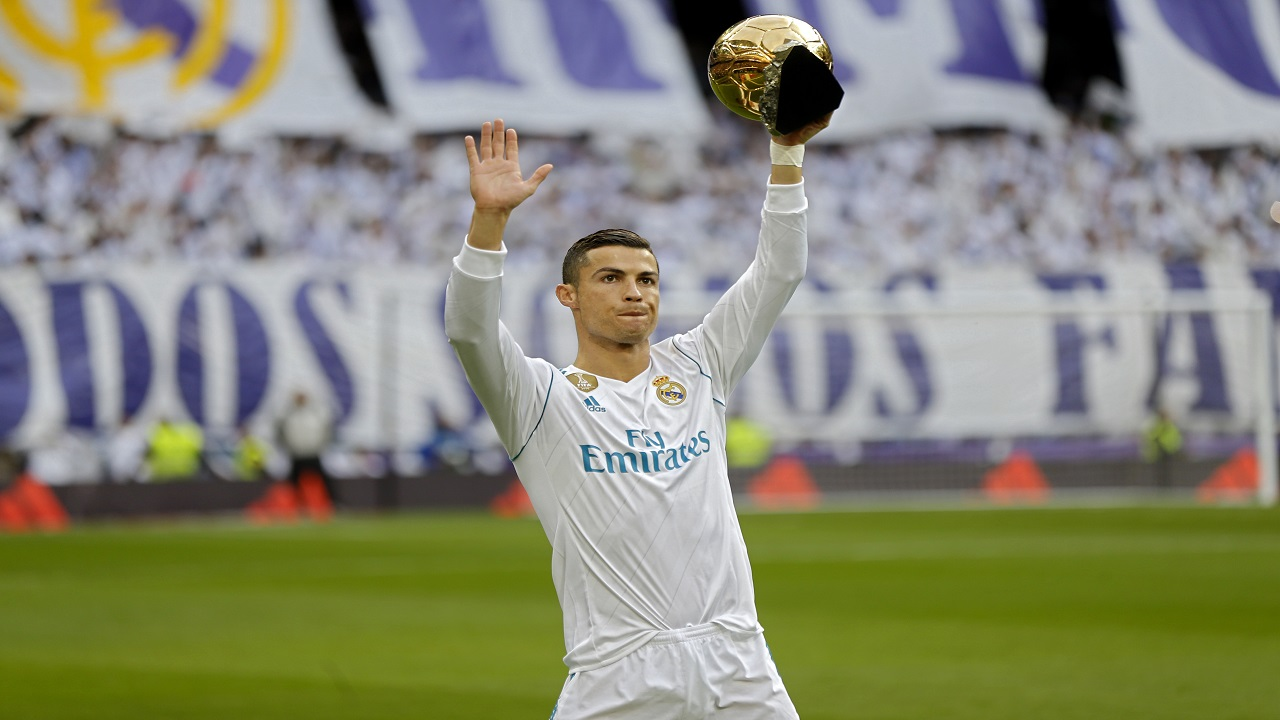Real Madrid's Cristiano Ronaldo holds up one of his five Golden Ball trophy prior the Spanish La Liga football match against Sevilla at the Santiago Bernabeu stadium in Madrid, Saturday, Dec. 9, 2017.