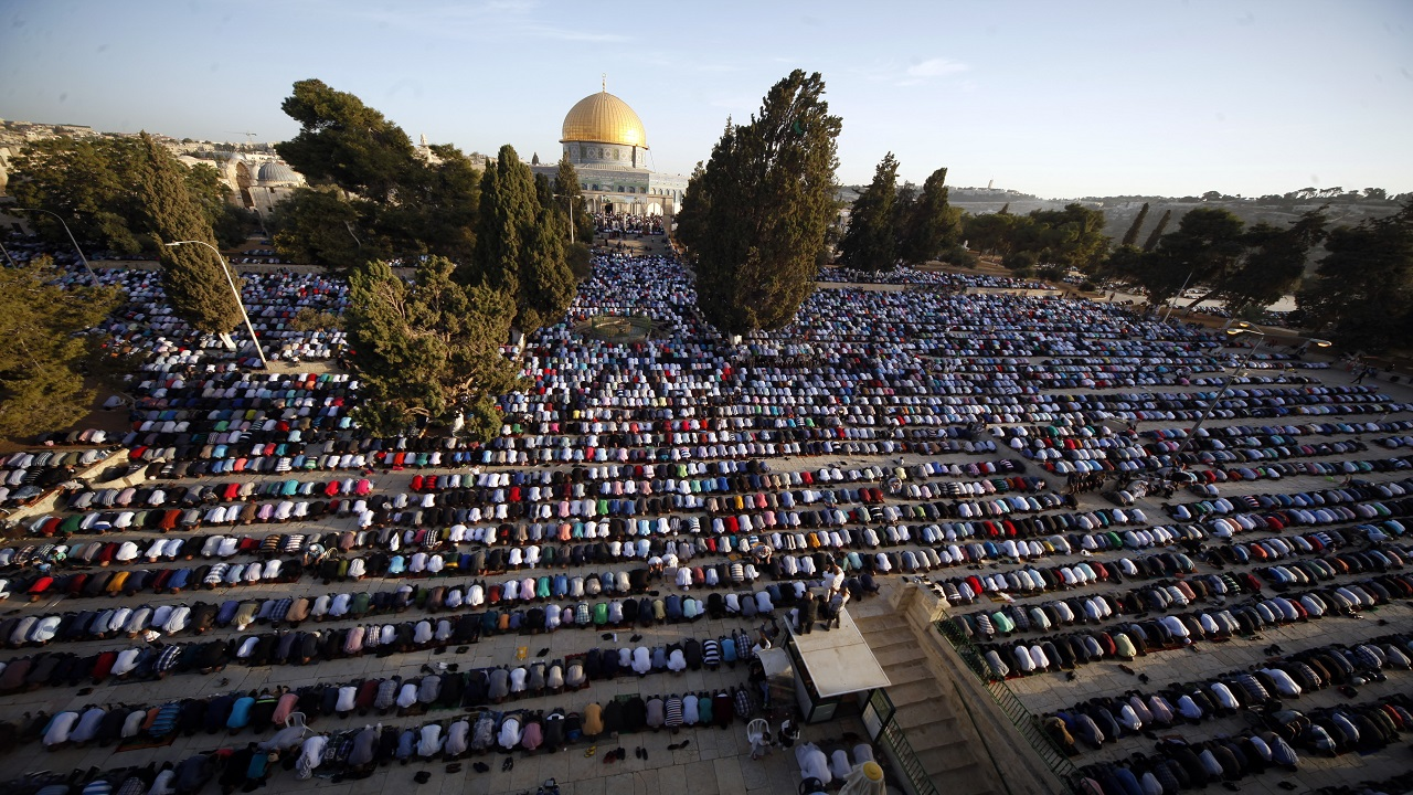 In this Sept. 24, 2015 file photo, Palestinians pray during the Muslim holiday of Eid al-Adha, near the Dome of the Rock Mosque in the Al Aqsa Mosque compound in Jerusalem's old city. Saudi Arabia has spoken out strongly against any possible U.S. recognition of Jerusalem as Israel's capital.