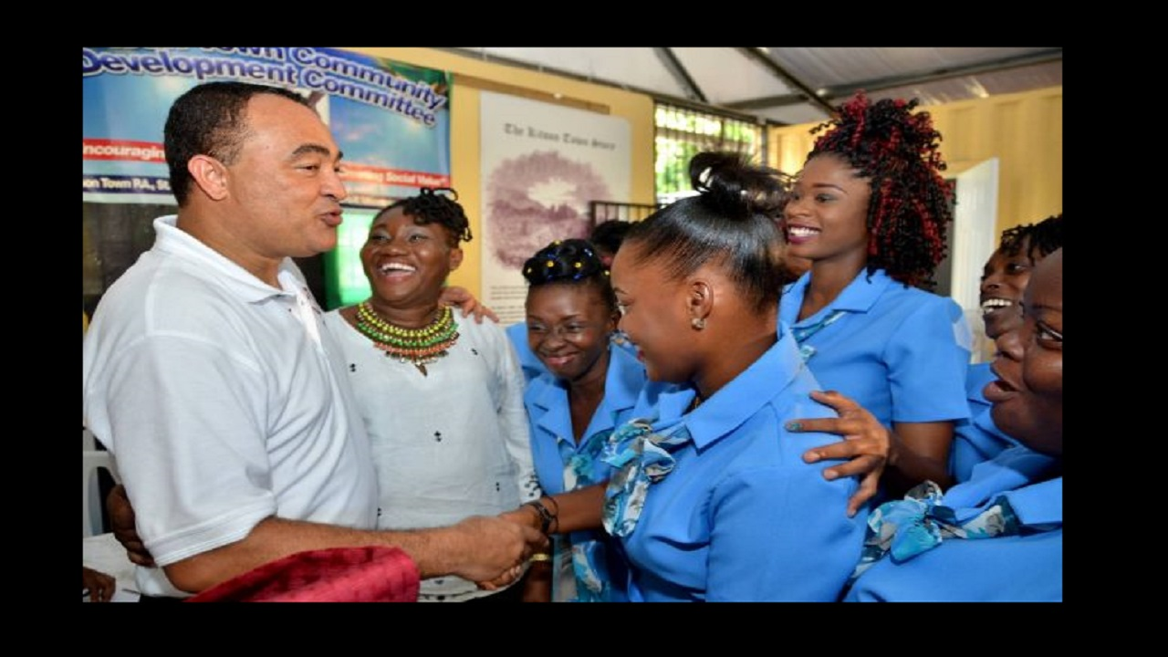 Health Minister and West Central St. Catherine Member of Parliament, Dr. the Hon. Christopher Tufton (left), interacts with Early Childhood Instructor for the training programme for unattached youth, Arlene Brown (2nd left), and students during the initiative's recent launch at the Kitson Town community resource centre via Jamaica Information Service.