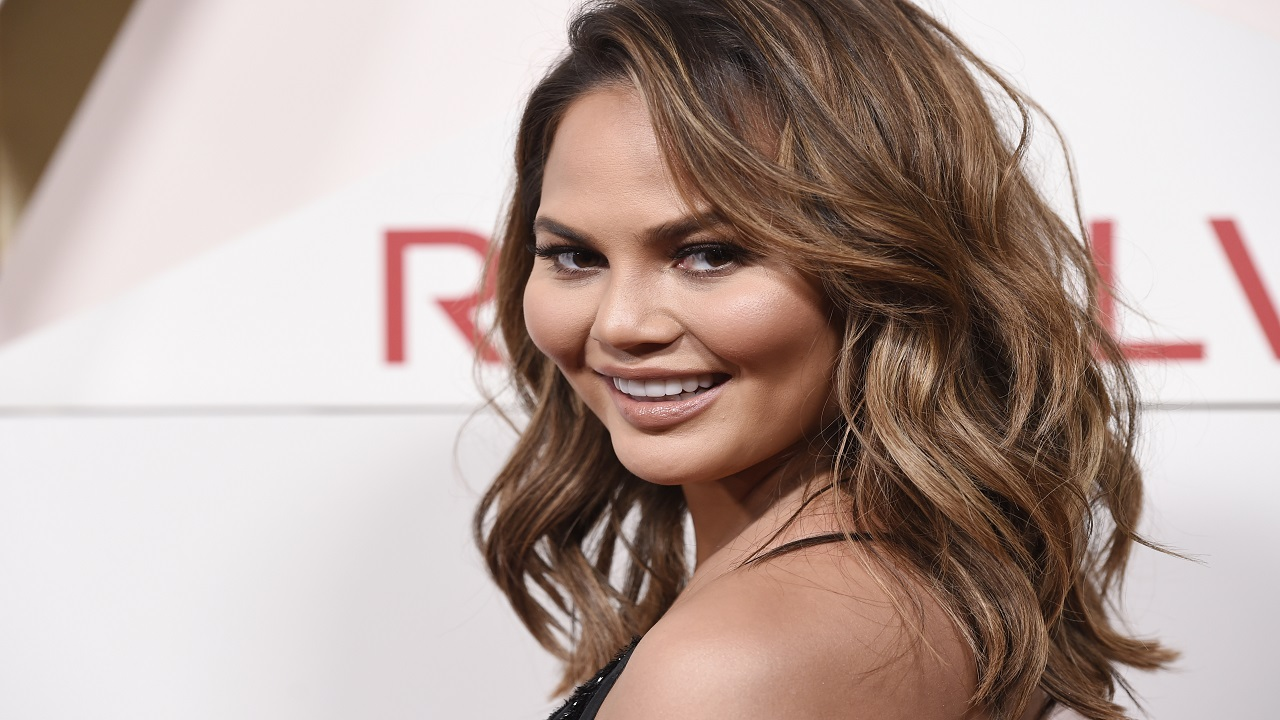 In this Nov. 2, 2017 file photo, model Chrissy Teigen poses at the 2017 Revolve Awards at the Dream Hollywood hotel in Los Angeles. An airline says a Tokyo-bound flight returned to Los Angeles hours into the journey after the crew discovered that one of the passengers had boarded the wrong plane. Teigen was aboard and live-tweeted the developments.
