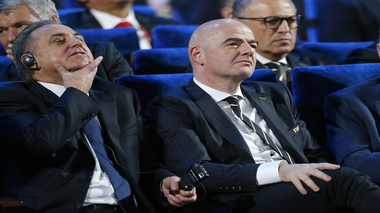 In this Dec. 1, 2017 file photo FIFA president Gianni Infantino, right, and Vitaly Mutko, Russian Federation Deputy Prime Minister & Local Organising Committee Chairman attend the 2018 football World Cup draw in the Kremlin in Moscow.