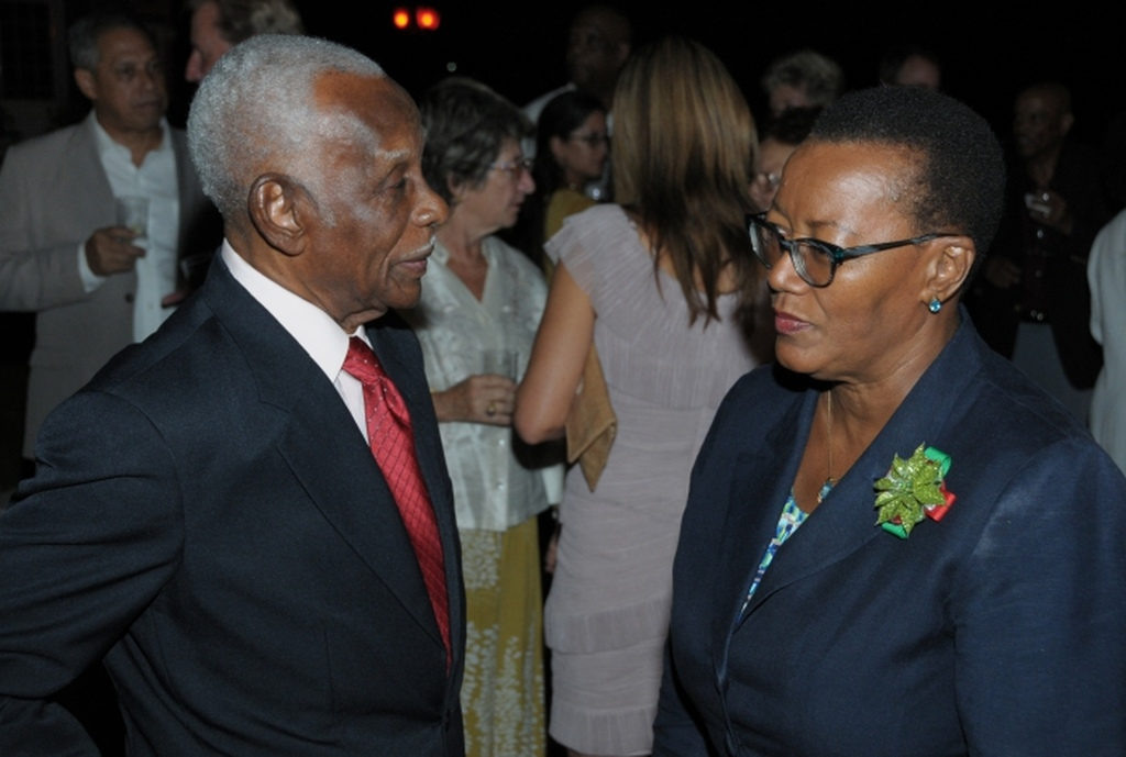 Honorary Consul, Dean of the Consular Corps, Selwyn Smith and Minister of Foreign Affairs, Senator Maxine McClean chatting during the reception at Southern Palms Hotel last night. (B.Hinds)