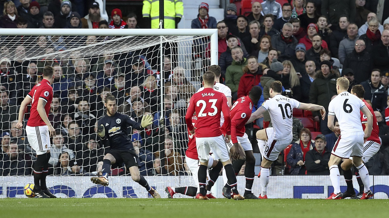 Burnley's Ashley Barnes scores his side's first goal of the game during their English Premier League football match against Manchester United at Old Trafford, Manchester, England, Tuesday, Dec. 26, 2017.