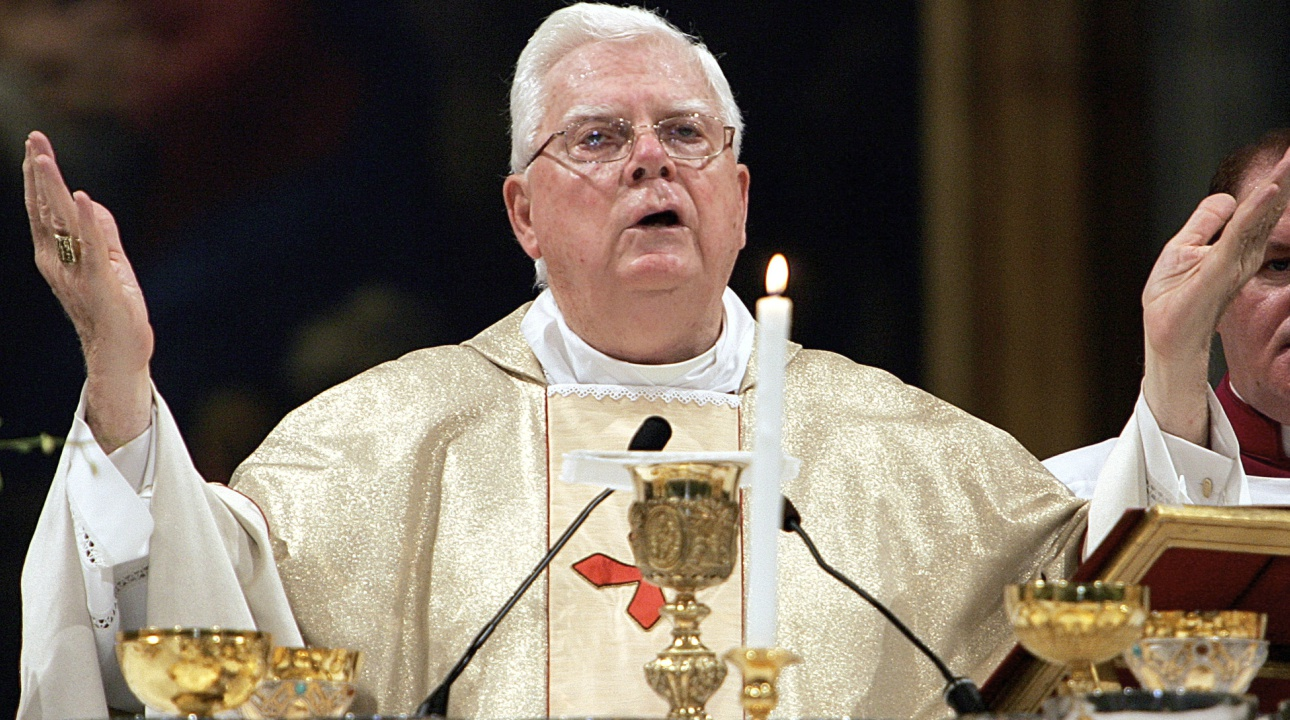 In this file photo, Cardinal Bernard Law celebrates Mass during the ceremony for Our Lady of the Snows, in St. Mary Major's Basilica, in Rome, Italy. (AP Photo/Domenico Stinellis, File)
