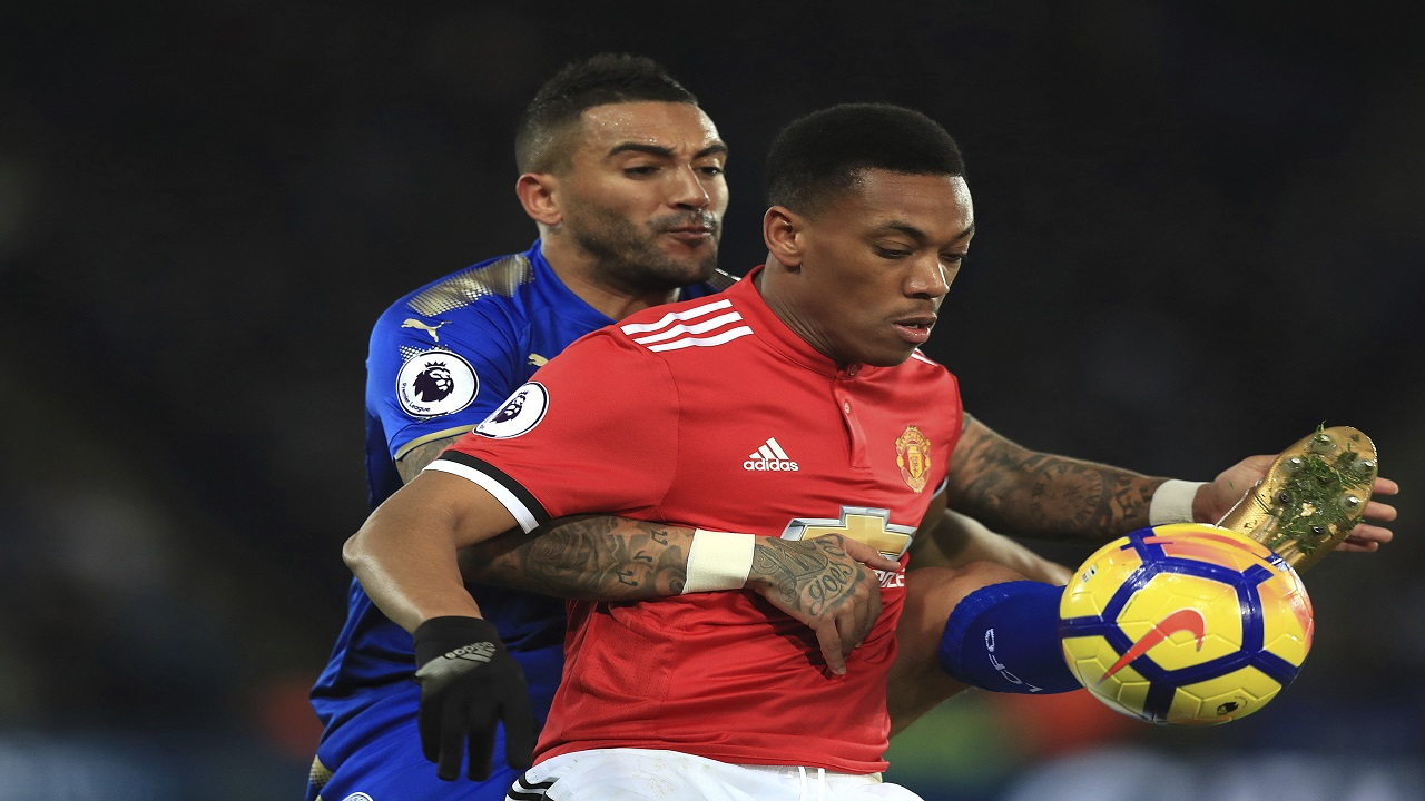 Leicester City's Danny Simpson, left, and Manchester United's Anthony Martial battle for the ball during their English Premier League football match at the King Power Stadium, Leicester, England, Saturday, Dec. 23, 2017.
