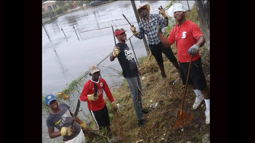 Some of the Orange Hill residents who participated in the cleanup.