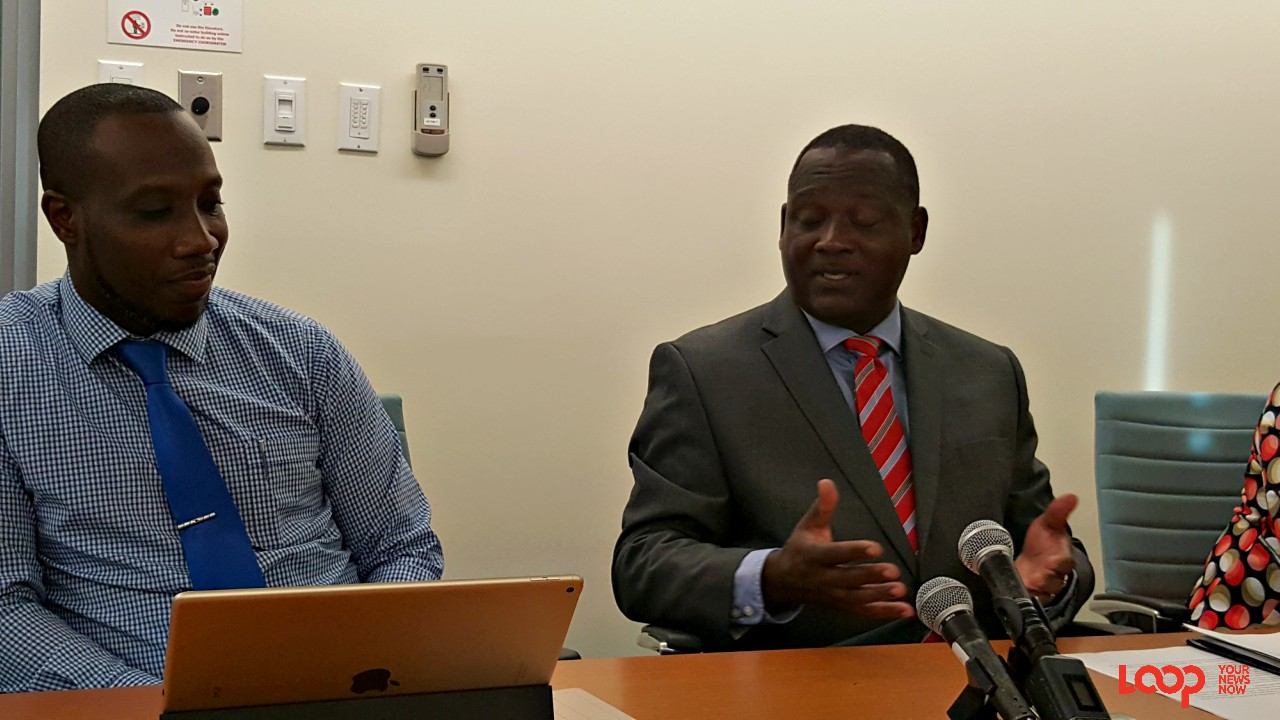 Director of International Business, Kevin Hunte and Minister of International Business Donville Inniss speak to the media after the EU named 17 countries in its 'blacklist' of tax havens.