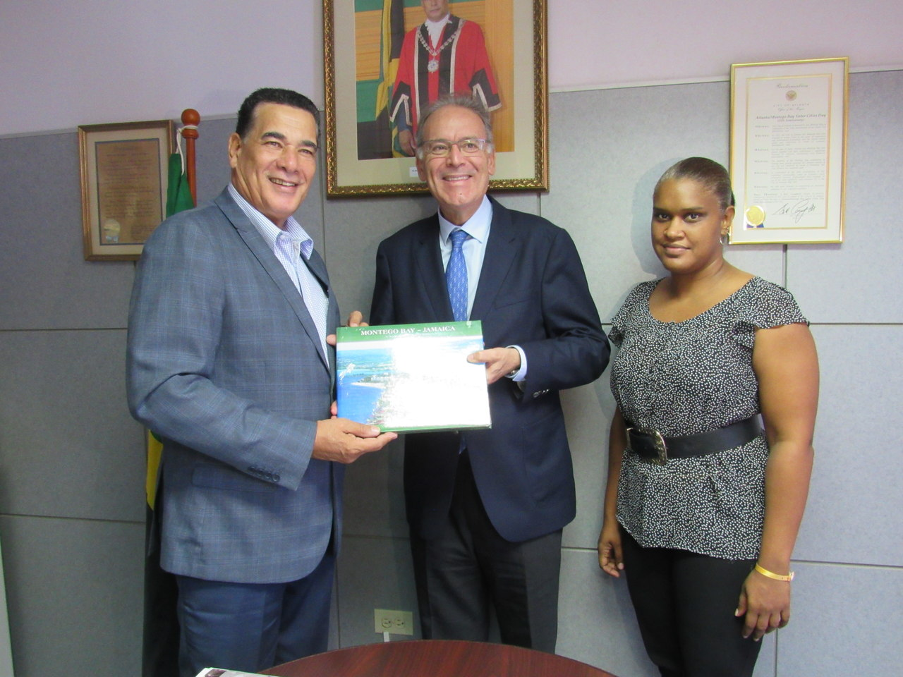 Montego Bay Mayor, Homer Davis (left), presents a book on the history of Montego Bay to Spanish Ambassador to Jamaica, Josep Bosch, after the ambassador paid him a courtesy call on Monday. Looking on is Project Manager with the Spanish Jamaica Foundation, Vanessa Meggoe.