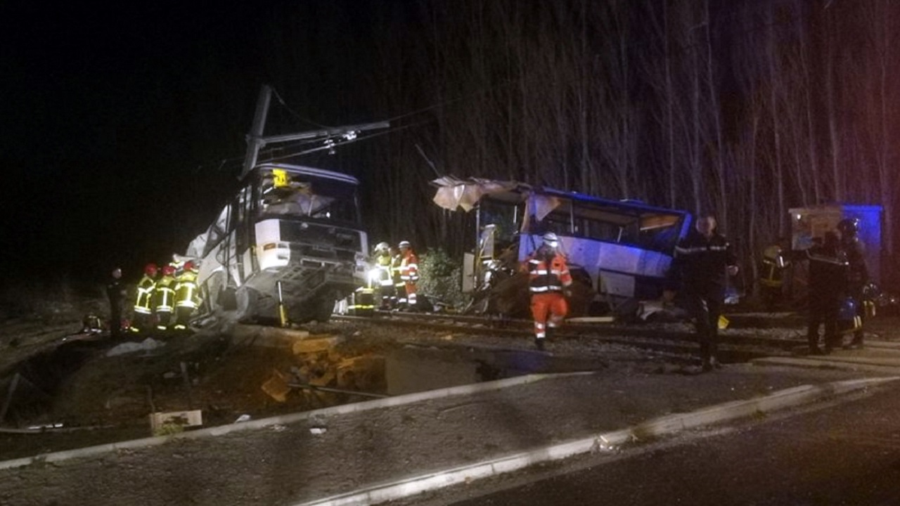 In this photo provided by France Bleu, rescue workers help after a school bus and a regional train collided in the village of Millas, southern France, Thursday, Dec. 14, 2017.