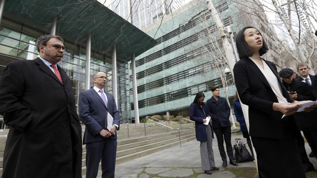 In this file photo, Mariko Hirose, right, a litigation director at the Urban Justice Center, speaks to reporters accompanied by Mark Hetfield, president & CEO of HIAS, left, and Rabbi Will Berkowitz, Jewish Family Service of Seattle CEO, in front of a federal courthouse in Seattle. (AP Photo/Elaine Thompson)