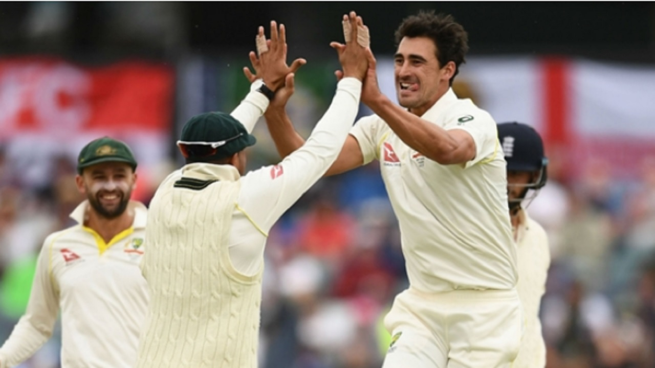 Mitchell Starc celebrates the wicket of James Vince.