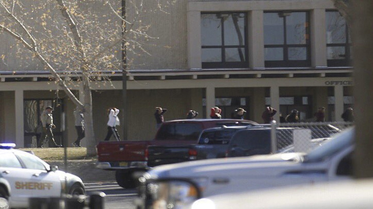Students are led out of Aztec High School after a shooting Thursday, Dec. 7, 2017, in Aztec, N.M. The school is in the Four Corners region and is near the Navajo Nation.