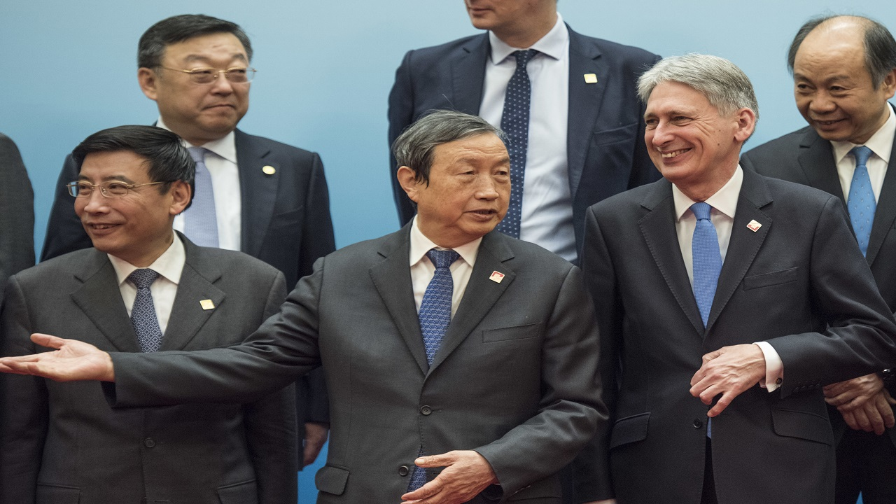 Britain's Chancellor of the Exchequer Philip Hammond, second from right, and Chinese Vice Premier Ma Kai, center, pose with delegates during the UK-China Economic Financial Dialogue at the Diaoyutai State Guesthouse in Beijing Saturday, Dec. 16, 2017.