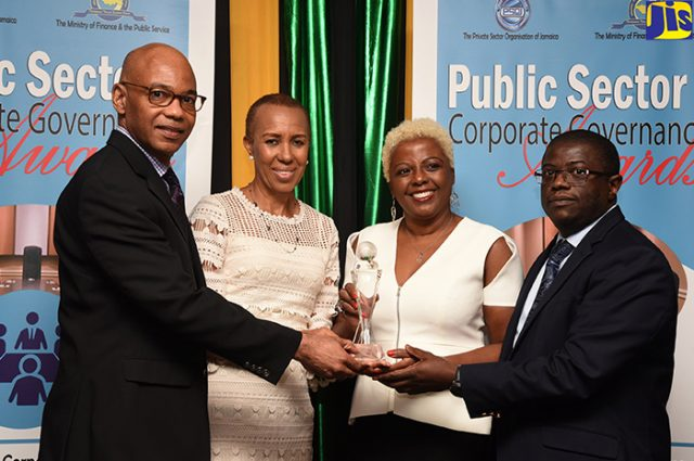Minister of State in the Ministry of Finance and the Public Service, Fayval Williams (second left); and Vice President, Private Sector Organisation of Jamaica, Dennis Cohen (left), present the Public Sector Corporate Governance (PSCG) Award for the 2016-2017 financial year to Director, National Health Fund, Cecile Watson (second right); and Chief Executive Officer, National Health Fund, Everton Anderson.