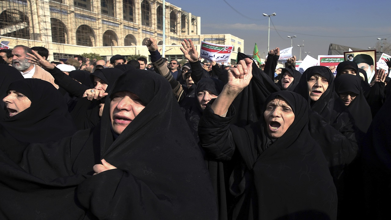 Iranian protesters chant slogans at a rally in Tehran, Iran, Saturday, Dec. 30, 2017. Iranian hard-liners rallied Saturday to support the country's supreme leader and clerically overseen government as spontaneous protests sparked by anger over the country's ailing economy roiled major cities in the Islamic Republic.