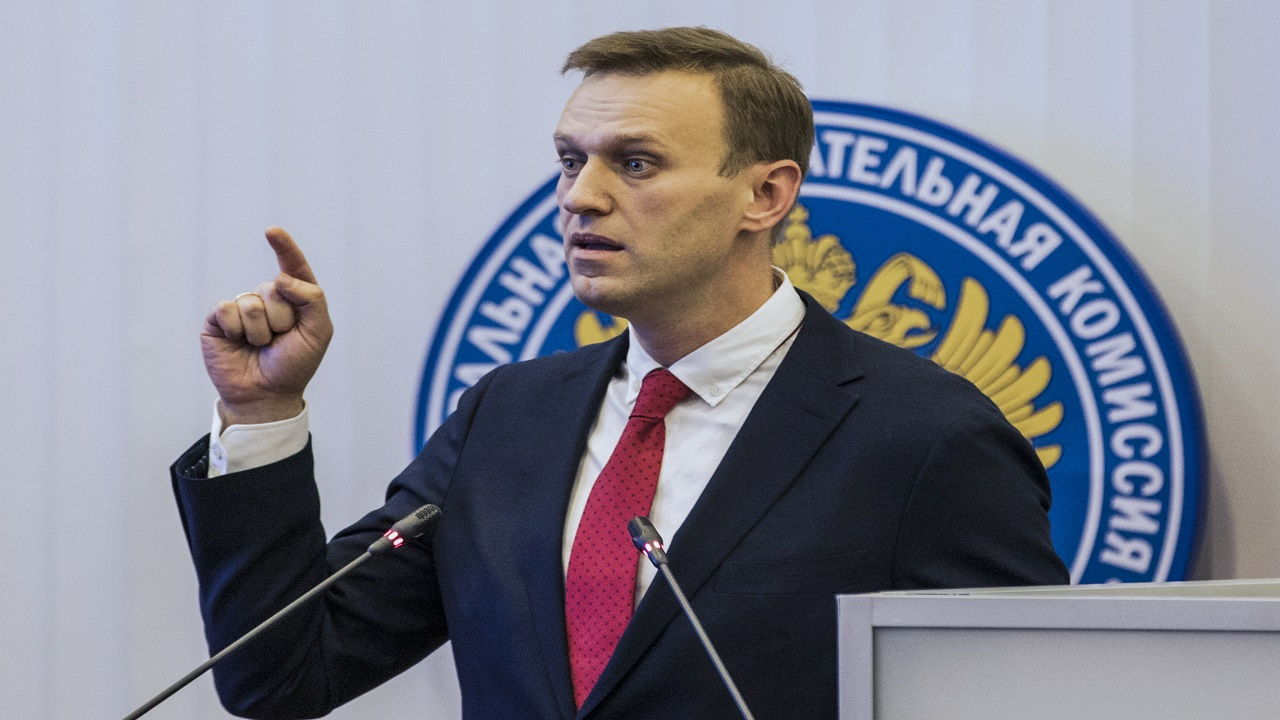 Russian opposition leader Alexei Navalny, who submitted endorsement papers necessary for his registration as a presidential candidate, gestures while speaking at the Russia's Central Election commission in Moscow, Russia, Monday, Dec. 25, 2017.