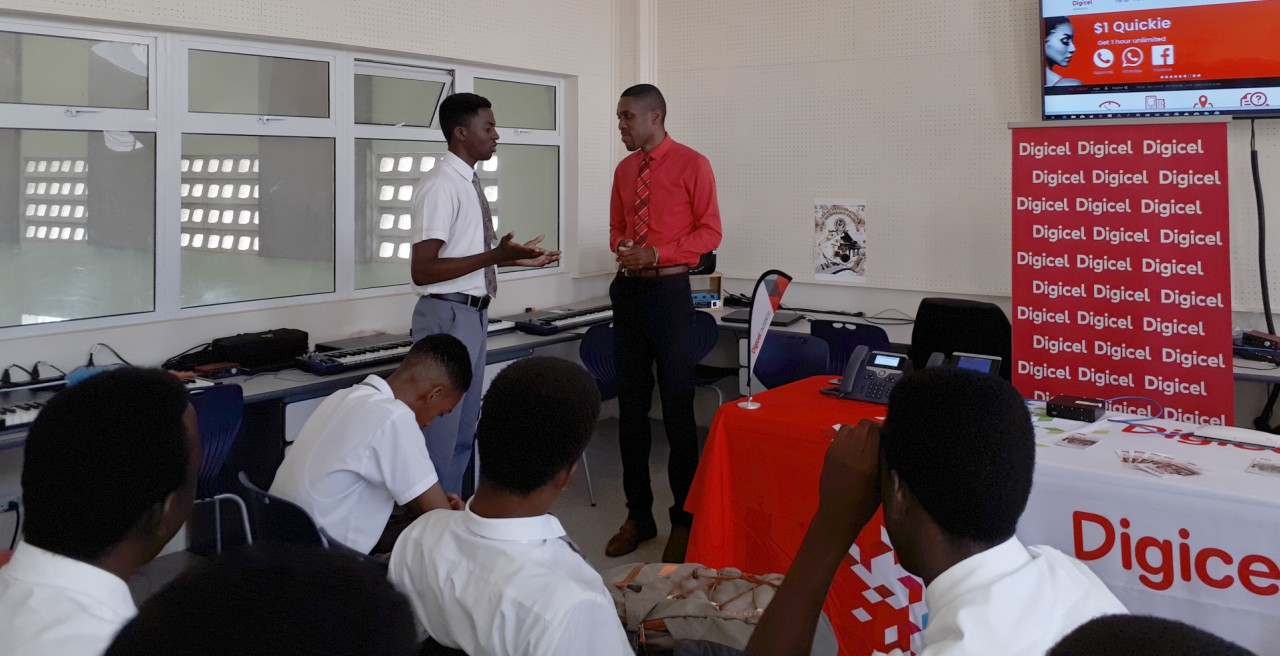St. Leonards Boy's Students listening attentively to the presentation by Digicel's Senior Design and Architect Engineer, Abdulshakoor Grazette during the school's Business and Career Showcase.