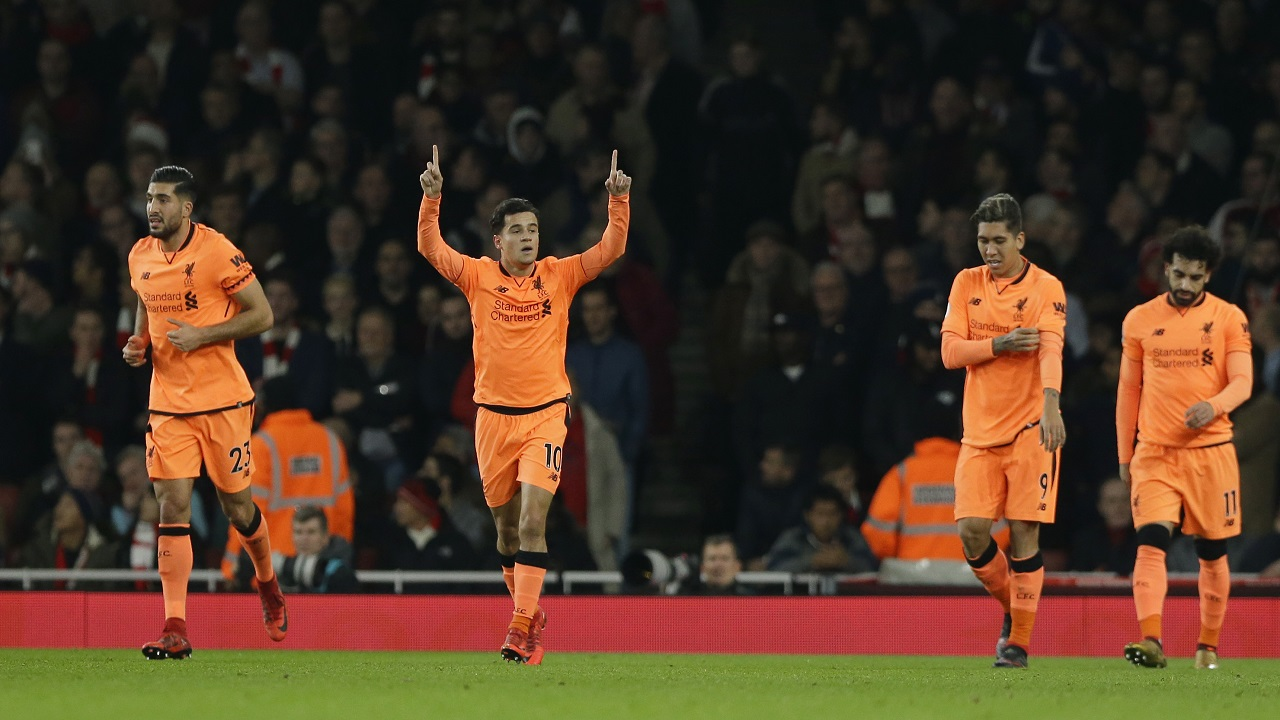 Liverpool's Philippe Coutinho, second left, celebrates after he scored the opening goal of the game during their English Premier League football match at the Emirates stadium London, Friday, Dec. 22, 2017.
