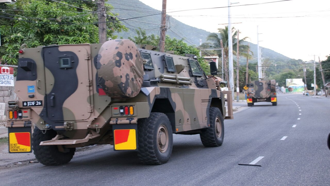 Heavy security in East Kingston earlier this week as tensions gripped the area. (file photo)