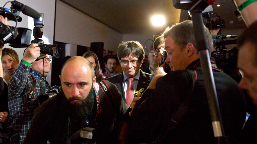 Ousted Catalan leader Carles Puigdemont, center, leaves after a press conference at the Square Meeting Center in Brussels on Thursday, Dec. 21, 2017. The pro-secession bloc won a majority in Catalan regional elections, but the anti-independence Ciutadans (Citizens), led by 36-year-old lawyer Ines Arrimadas, won the highest number of votes for a single party. Several members of the ousted Cabinet have campaigned from Brussels, where they sought refuge from Spanish justice. (AP Photo/Virginia Mayo)