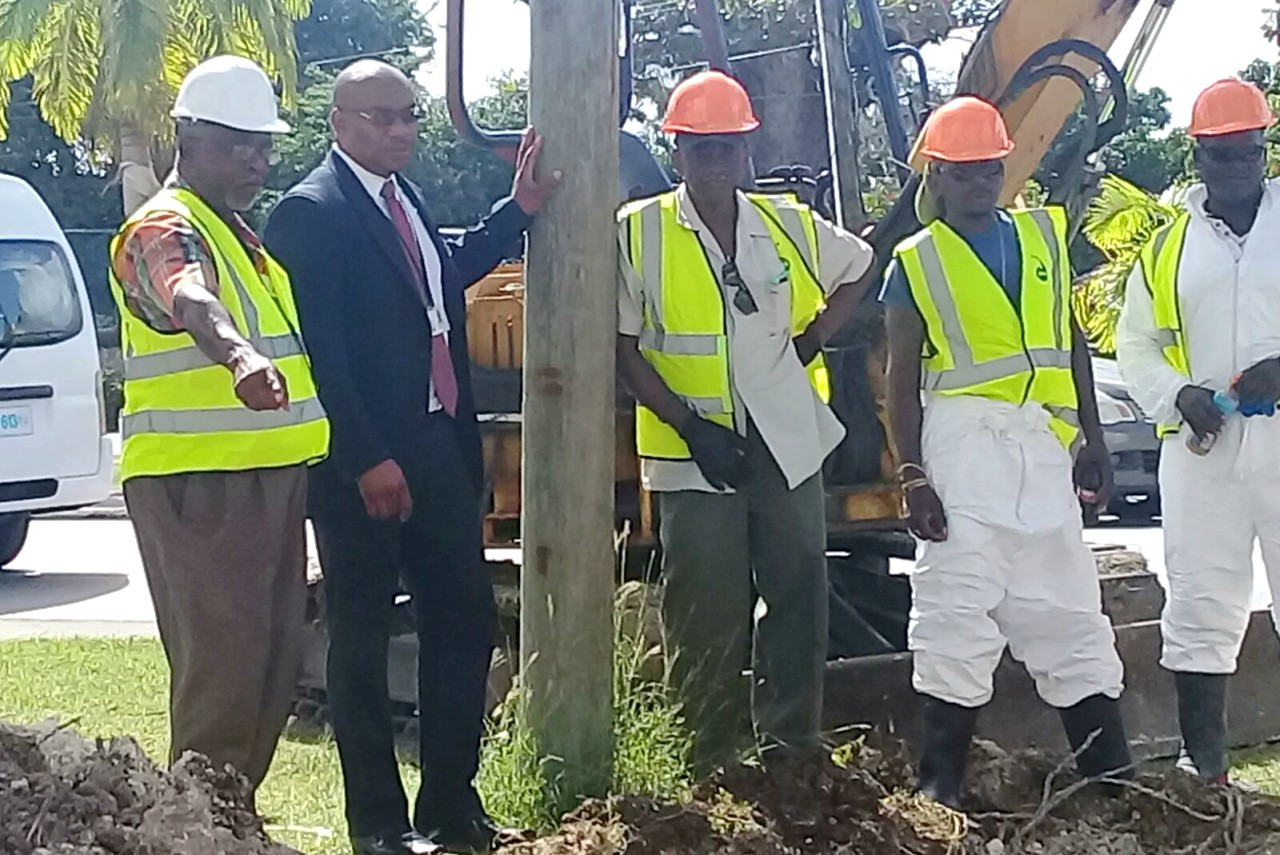 (second from left) General Manager of the Barbados Water Authority (BWA) Keothroy Halliday and employees of the BWA at the Bay Street Lift Station today.