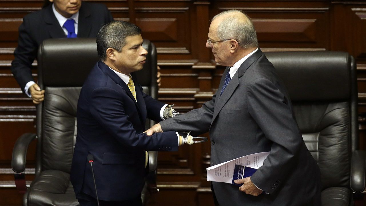 Peru's President Pedro Pablo Kuczynski , right, shakes hands with National Congress President Luis Galarreta in Lima, Peru, Thursday, Dec. 21, 2017.