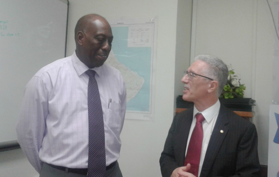 Chief Executive Officer of the Queen Elizabeth Hospital (QEH), Dr. Dexter James (left) in conversation with the representative of the Pan-American Health Organization (PAHO) and the World Health Organization (WHO), Dr. Godfrey Xerub.