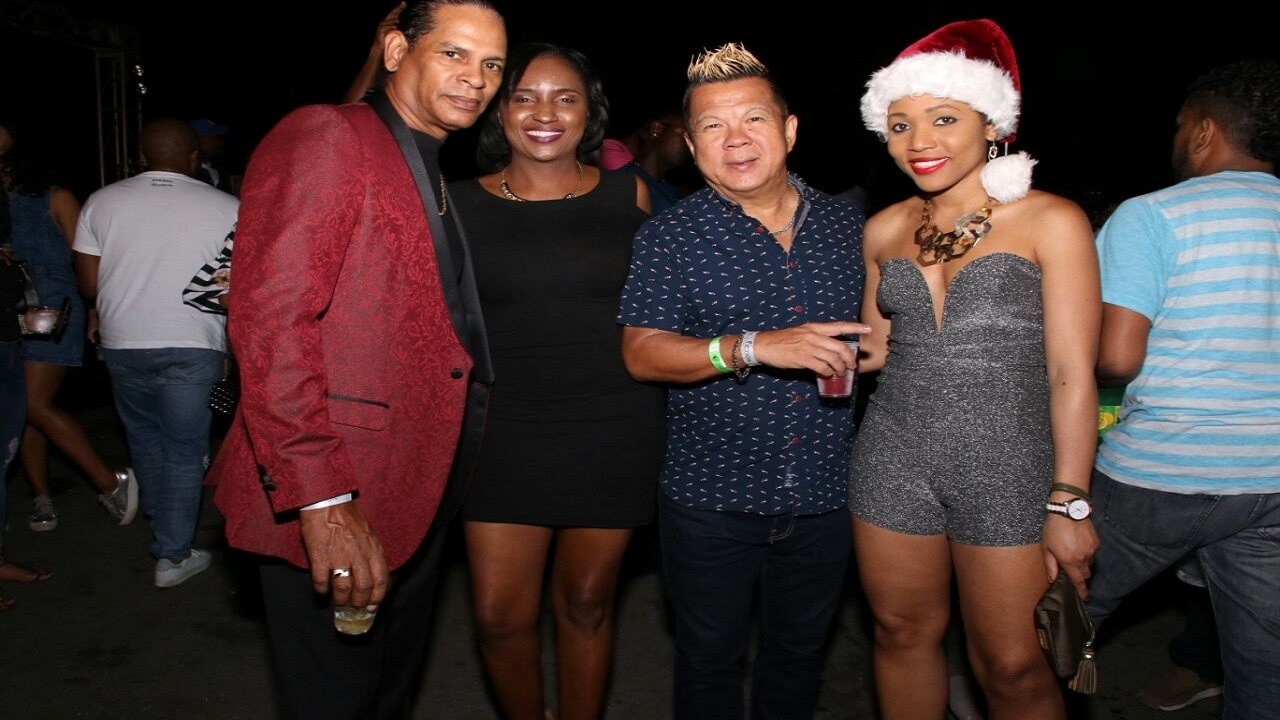 Popular businessmen Carlos Max-Brown (left) and Brian 'Ribbie' Chung, pictured with two female companions, were among the patrons at the Renaissance party on Friday. (PHOTOS: Llewellyn Wynter)