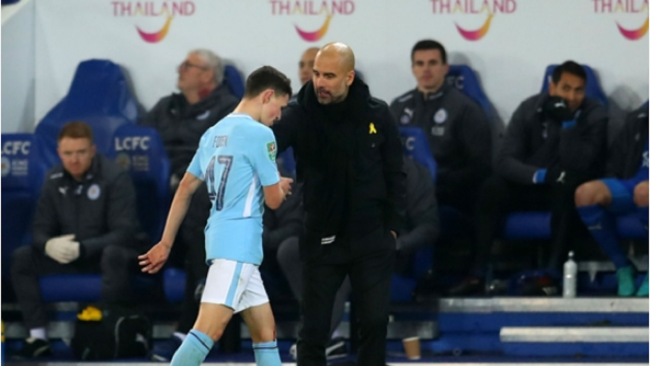 Phil Foden and Pep Guardiola.