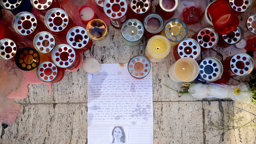 FILE - A Tuesday Oct. 17, 2017 file photo showing candles, notes and paper cuttings next to the Love Monument in St. Julian, Malta, the day after the killing of journalist Daphne Caruana Galizia. At least 81 reporters were killed doing their jobs this year, while violence and harassment against media staff has skyrocketed, the world's biggest journalists' organisation says. (AP Photo/Rene Rossignaud, File)