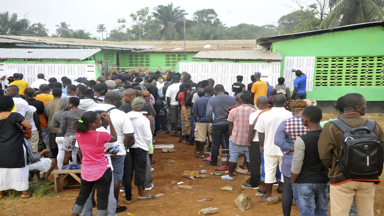 People wait to cast their votes during a Presidential runoff election in Monrovia, Liberia, Tuesday, Dec. 26, 2017.