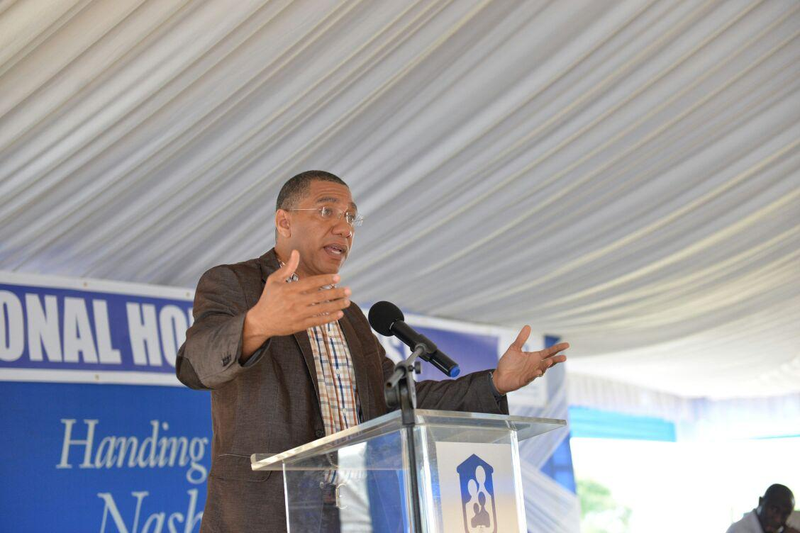 Prime Minister Andrew Holness addresses the recent handing-over of 40 news houses in the Nashville Mews housing development in St Mary. (Photos: Llewelyn Wynter)