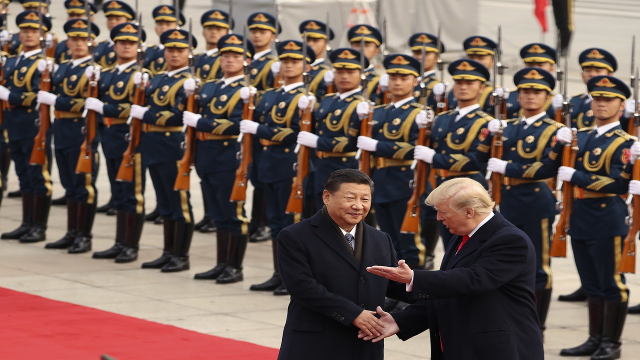In this Nov. 9, 2017, file photo, President Donald Trump and Chinese President Xi Jinping participate in a welcome ceremony at the Great Hall of the People in Beijing, China.