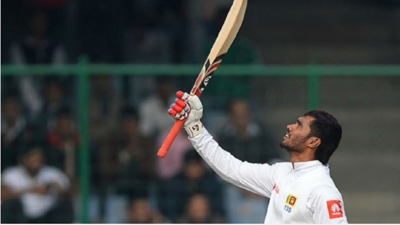 Dhananjaya de Silva celebrates his hundred.