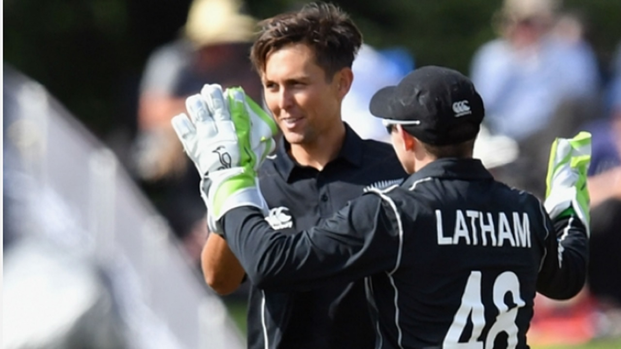 New Zealand seamer Trent Boult celebrates with stand-in captain and wicketkeeper Tom Latham.