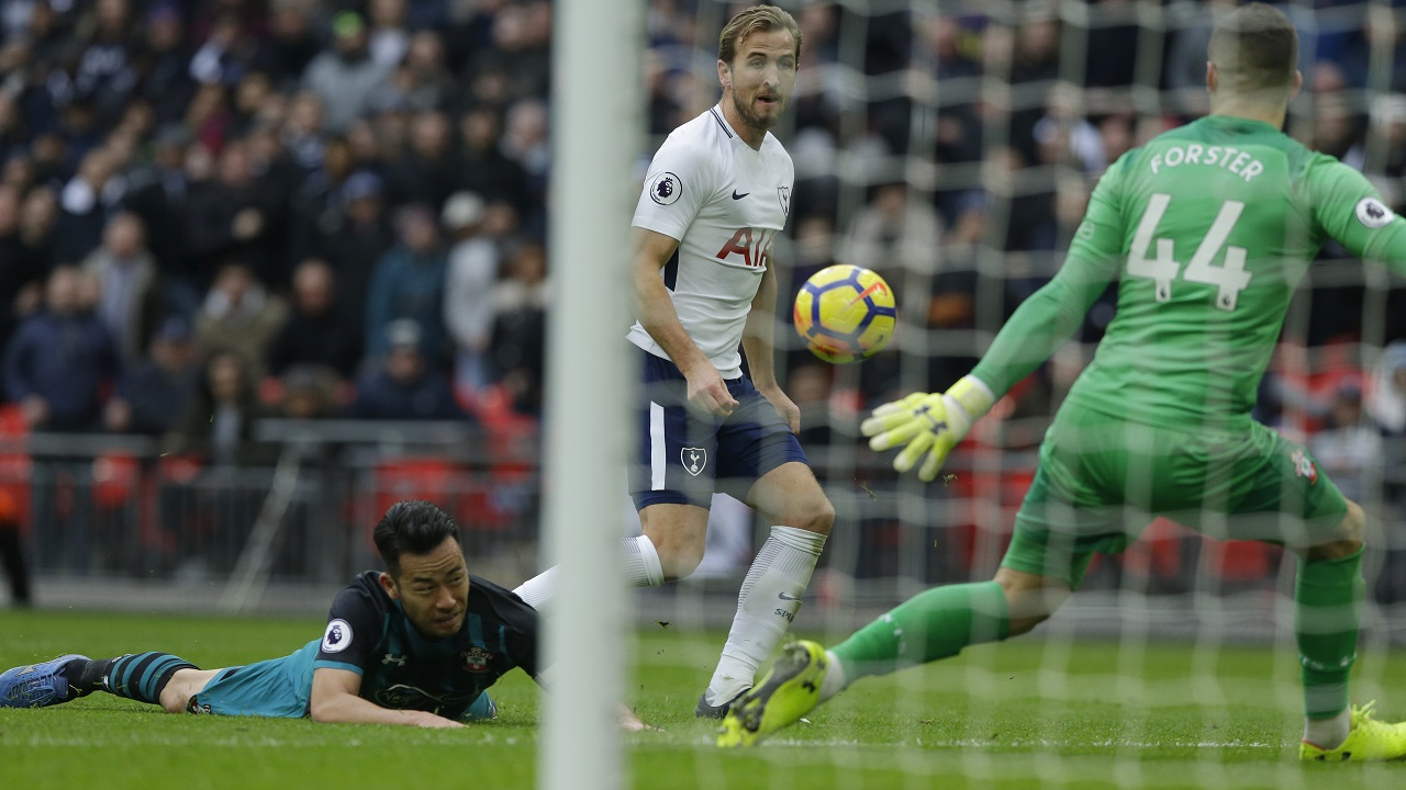 Tottenham Hotspur's Harry Kane watches as he scores his sides 5th goal and his third of the game during their English Premier League football match against Southampton at Wembley stadium in London Tuesday, Dec 26 2017.