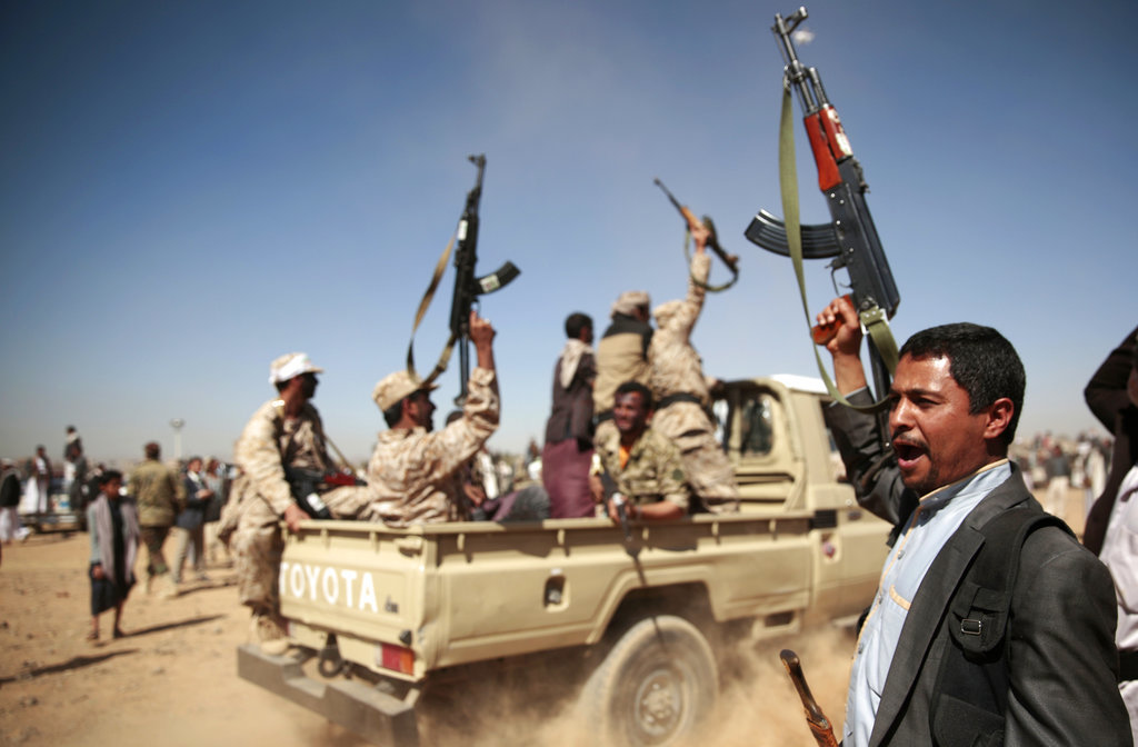 In this file photo, tribesmen loyal to Houthi rebels chant slogans during a gathering aimed at mobilizing more fighters into battlefronts to fight pro-government forces, in Sanaa, Yemen. `(AP Photo/Hani Mohammed, File)