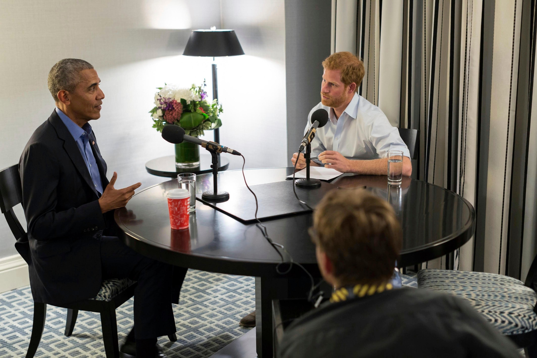 In this photo issued by Kensington Palace courtesy of the Obama Foundation, Britain's Prince Harry, right, interviews former US President Barack Obama. (Kensington Palace courtesy of The Obama Foundation via AP)