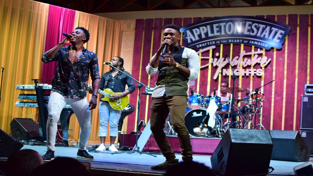 Romain Virgo (left) with Christopher Martin at the Appleton Estate Signature Nights finale.