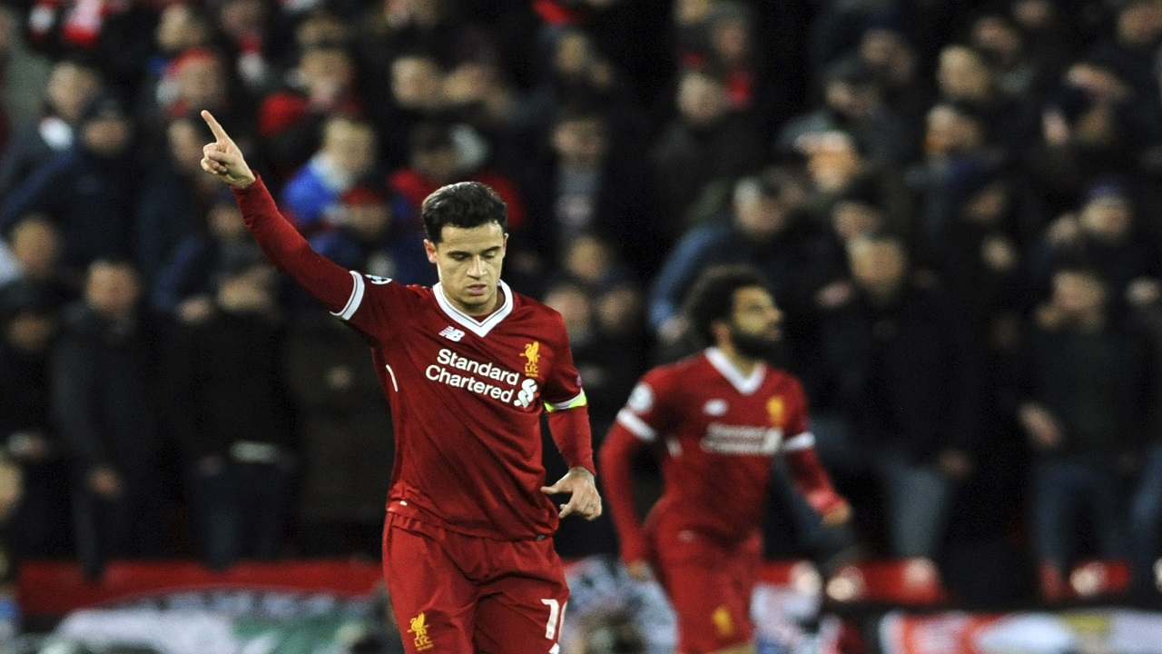 Liverpool's Philippe Coutinho, left, celebrates after scoring his side's second goal during the Champions League Group E football match against Spartak Moscow at Anfield, Liverpool, England, Wednesday, Dec. 6, 2017.